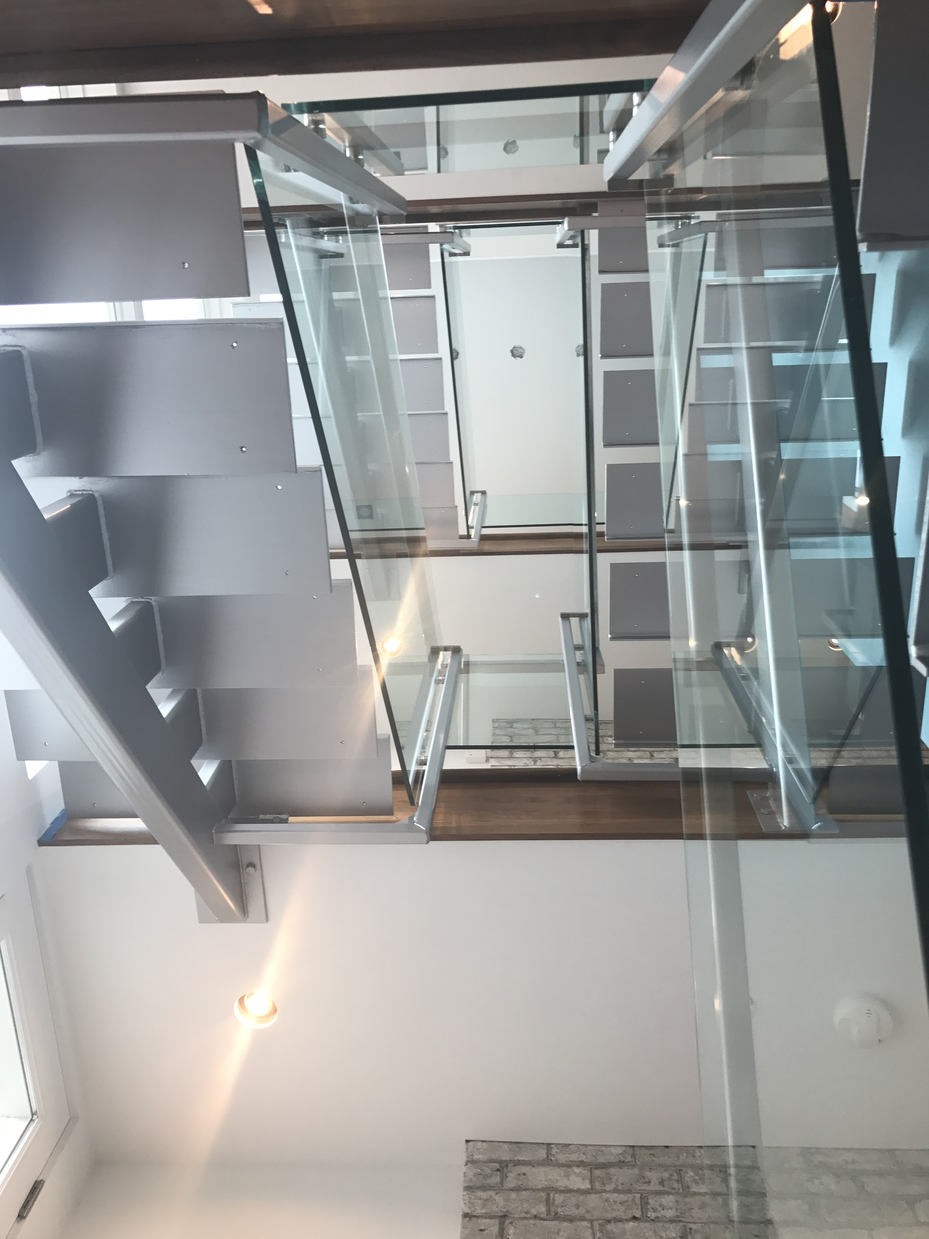 mono-stringer staircase, stainless steel handrail, handrail, steel staircase, custom handrail, custom staircase